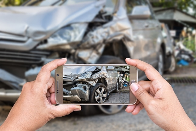 Taking a photo of an accident scene.